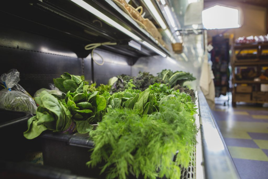 Bunches of fresh greens sit temptingly in the Cortes Co-op produce cooler.
