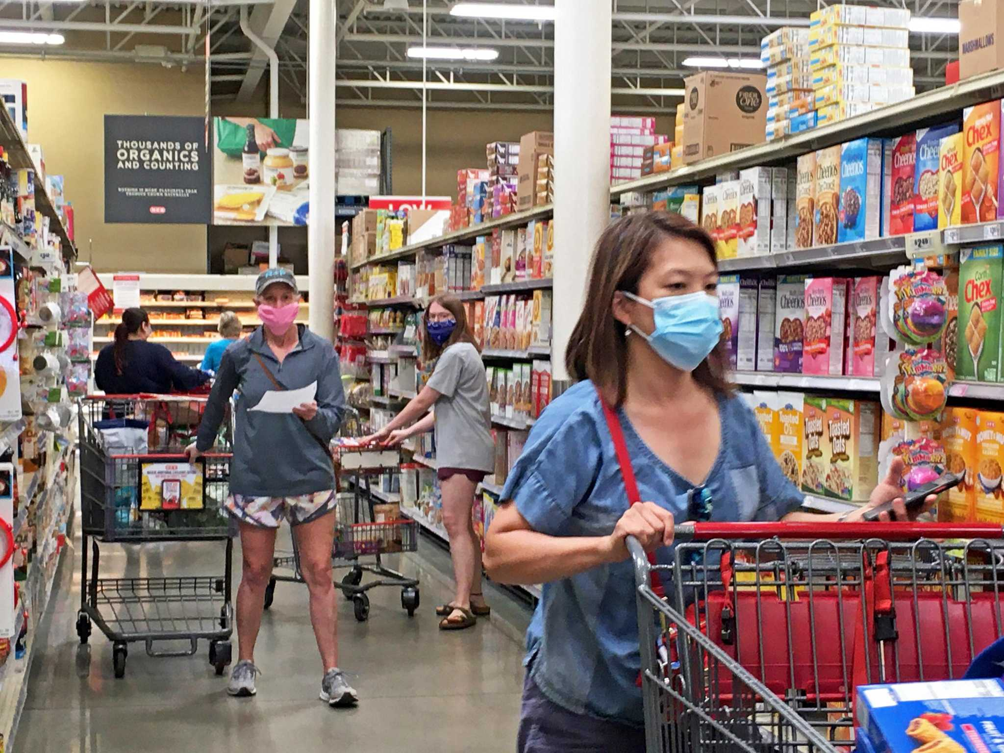 Wearing masks while visiting the Co-op